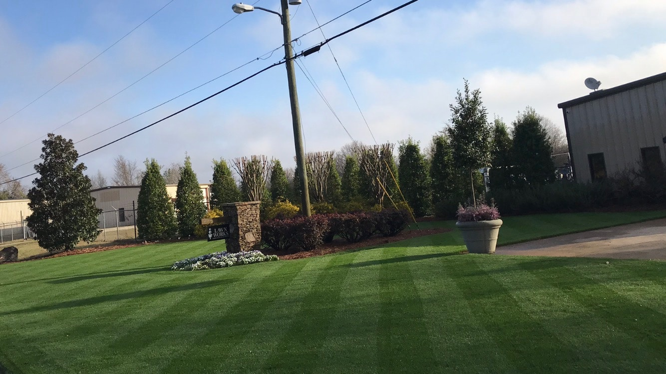Our lawn care service office in the Macon & Warner Robins area. The lawn is dark green and striped. It is maintained by our lawn care treatment specialist.